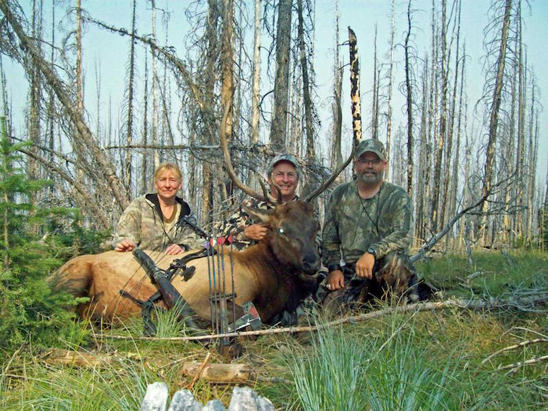 rep photo Paul Martin, Craig, Diann with Paul's 2017 bull
