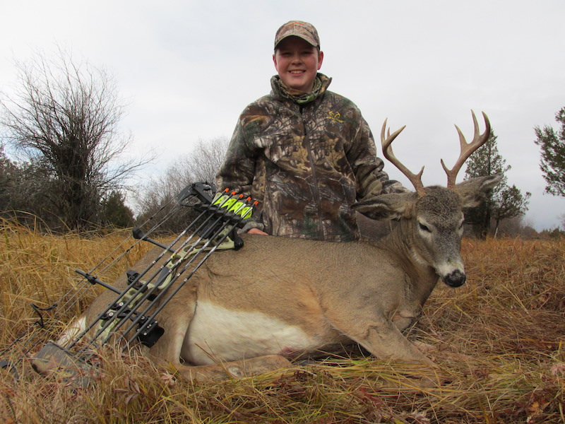 Despite a heavy west wind, Bridger Kamps stuck it out in his treestand and took this nice 4 point buck with a well placed 7 yard shot.