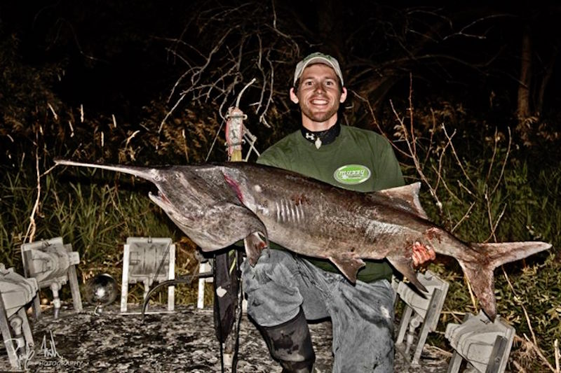 Brady Miller from West Glacier with paddlefish weighing in at 45.25 pounds